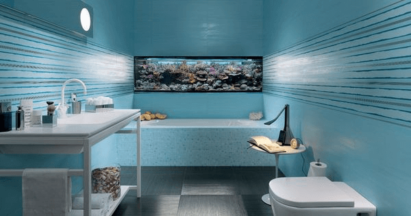 Fish tank in bathroom wall