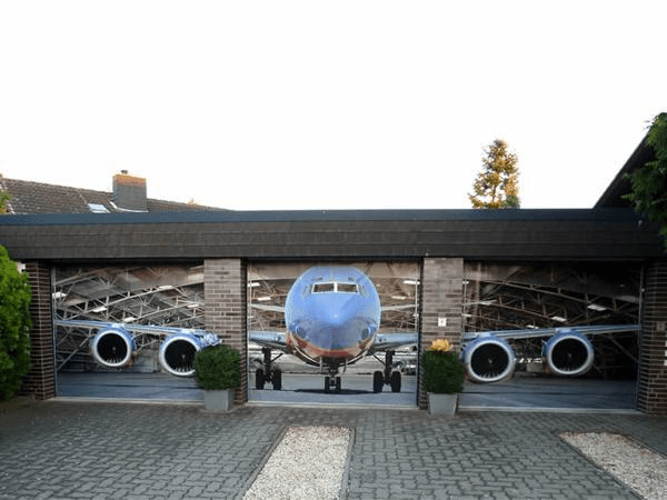 Outdoor garage wall decor with plane sticker design