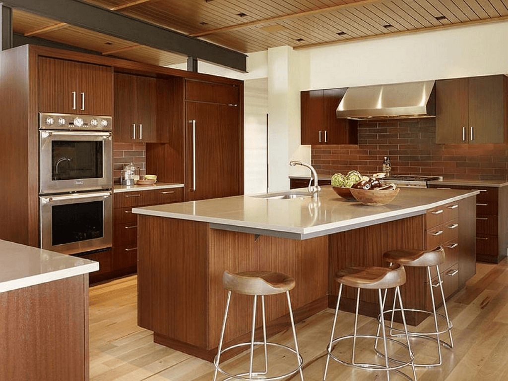 Brown large kitchen island with storage and seating