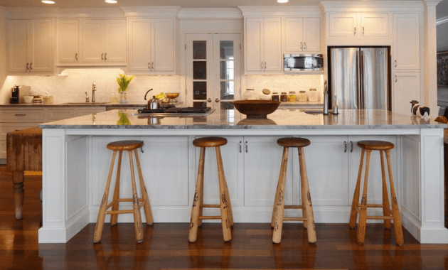 Kitchen island with baseball bar stool seating and porcelain counter top