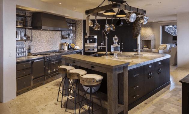 Large black kitchen island with sink