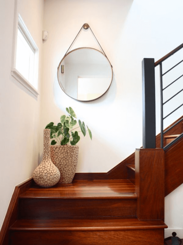 Stairs with landing and round wall mirror