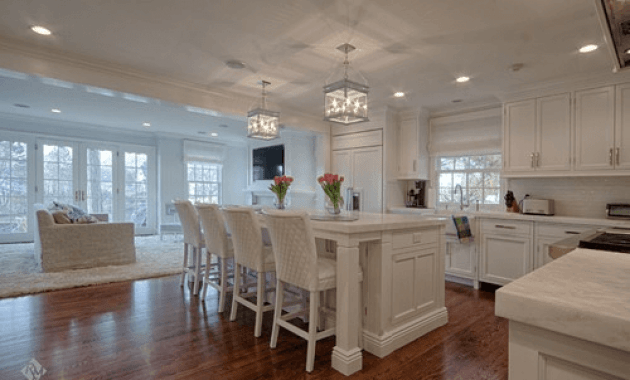 White kitchen island with cabinets on both sides