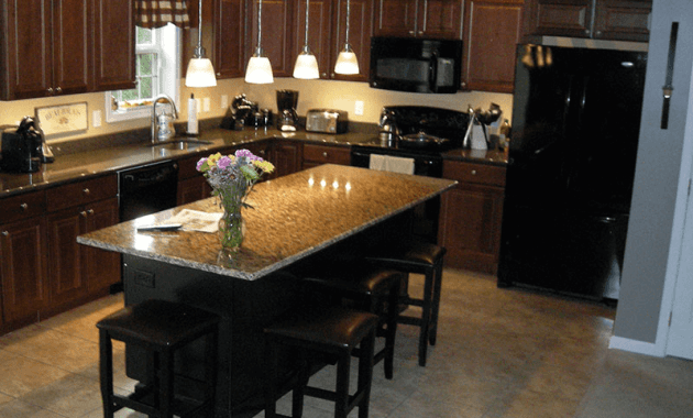Brown Kitchen island with overhang granite countertop and nice decoration