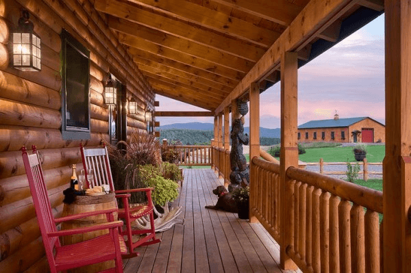 Log cabin patio decoration with red rocking chairs