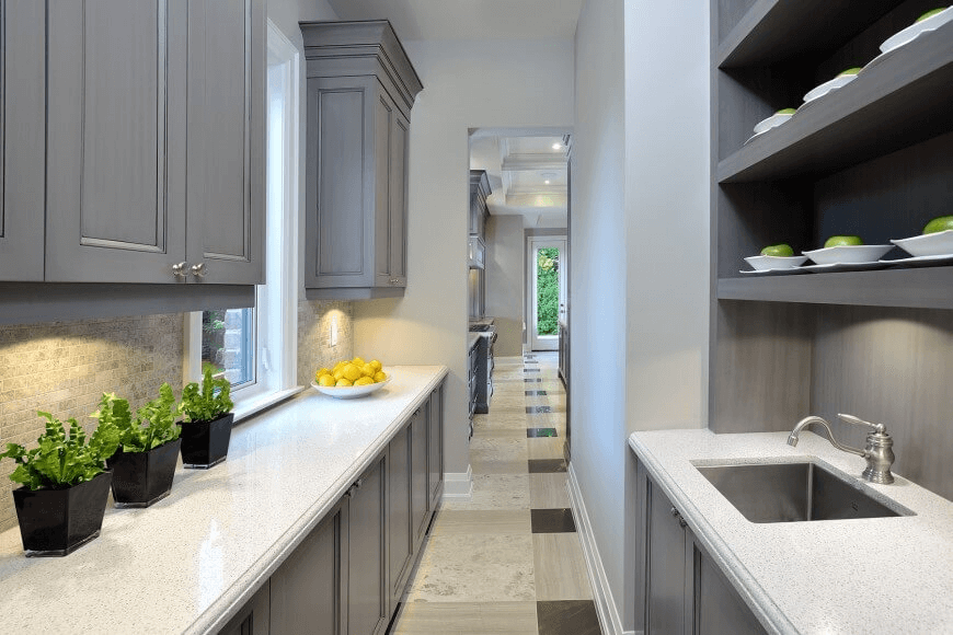 White Slim countertop with flower pot and grey kitchen cabinet