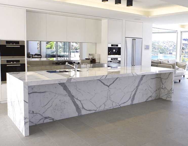 White kitchen island with marble top
