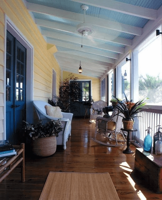 Brown floor, blue ceiling porch, and yellow wall painting