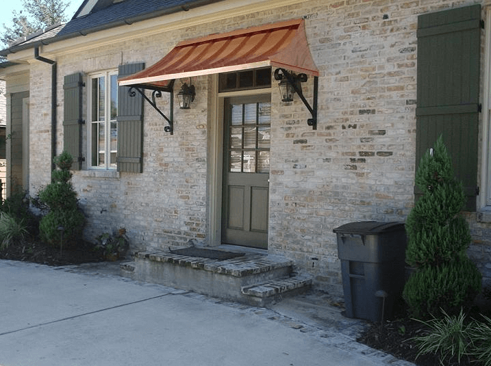 Cooper front door awning design with brick wall