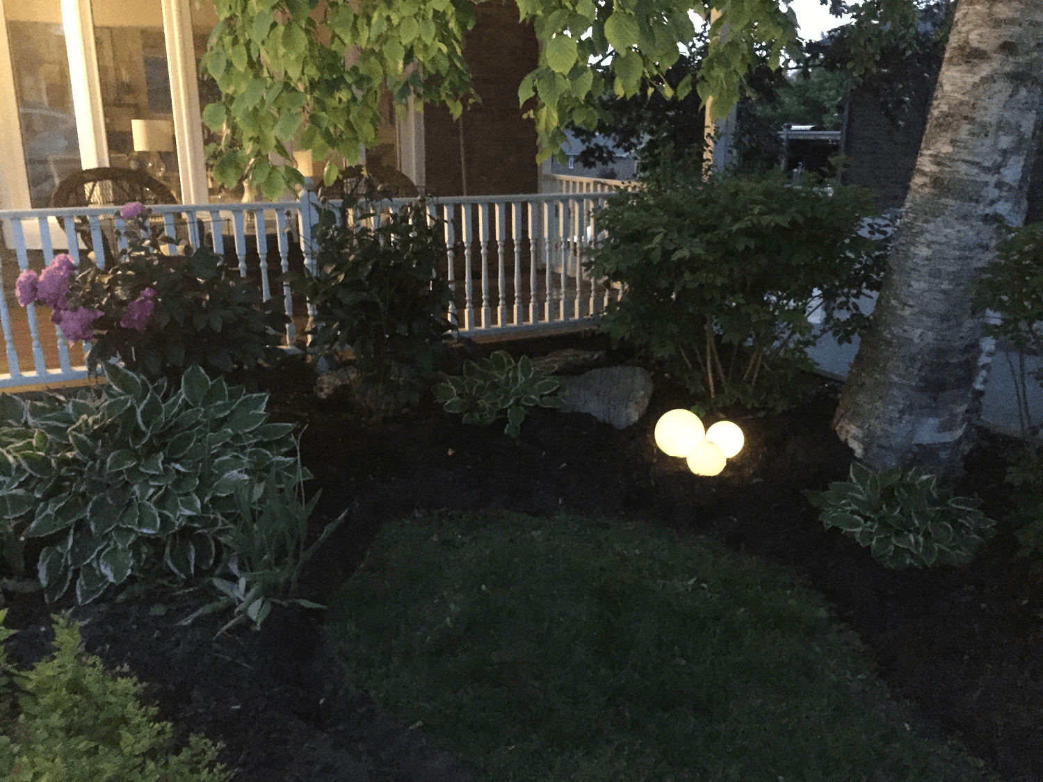 Glowing orb lighting front porch