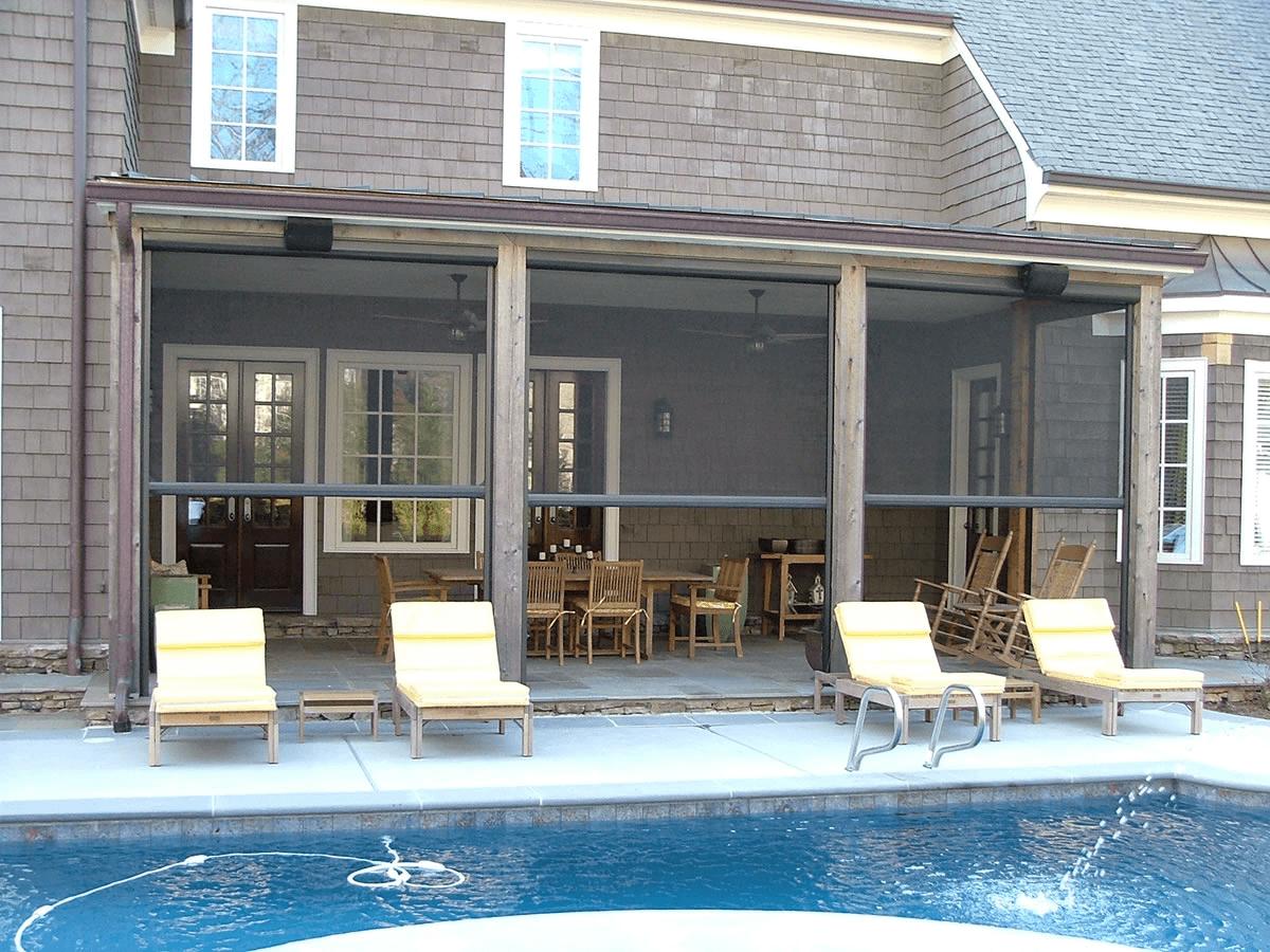 Motorized patio screen enclosures