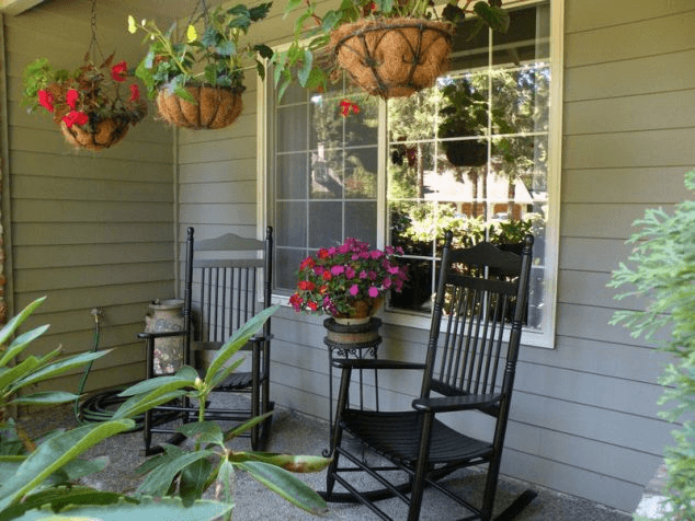 Oak black front porch rocking chairs with hanging flower pot