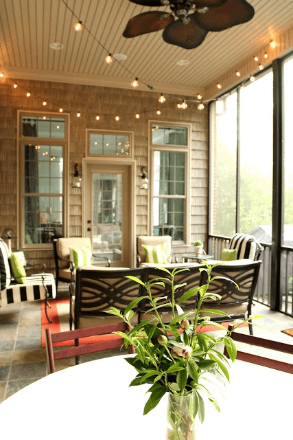 Rope Lights and Wall Sconces at screened in porch under deck