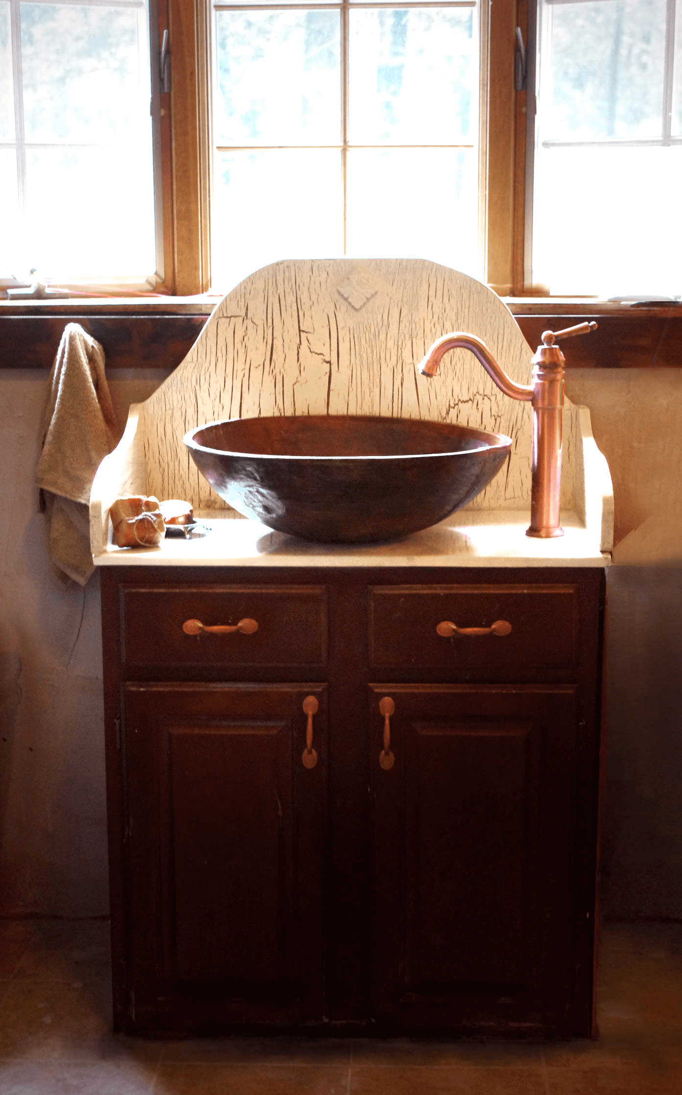Antique bathroom vanity with bowl vessel sink