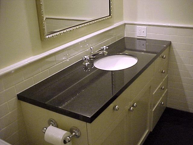 Bath vanity with black granite top