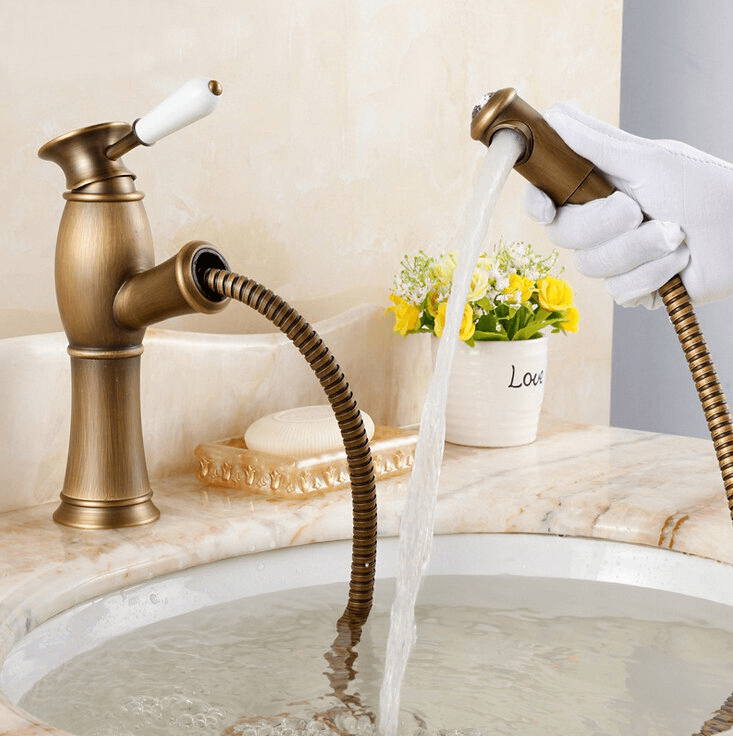 Bathroom sink faucets with pull out sprayer