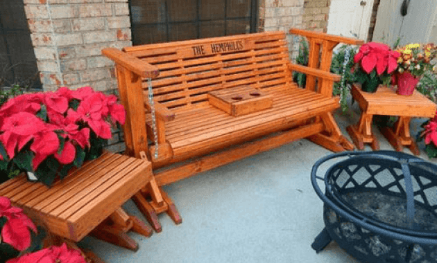 Front porch glider swing decoration with table and flower pots