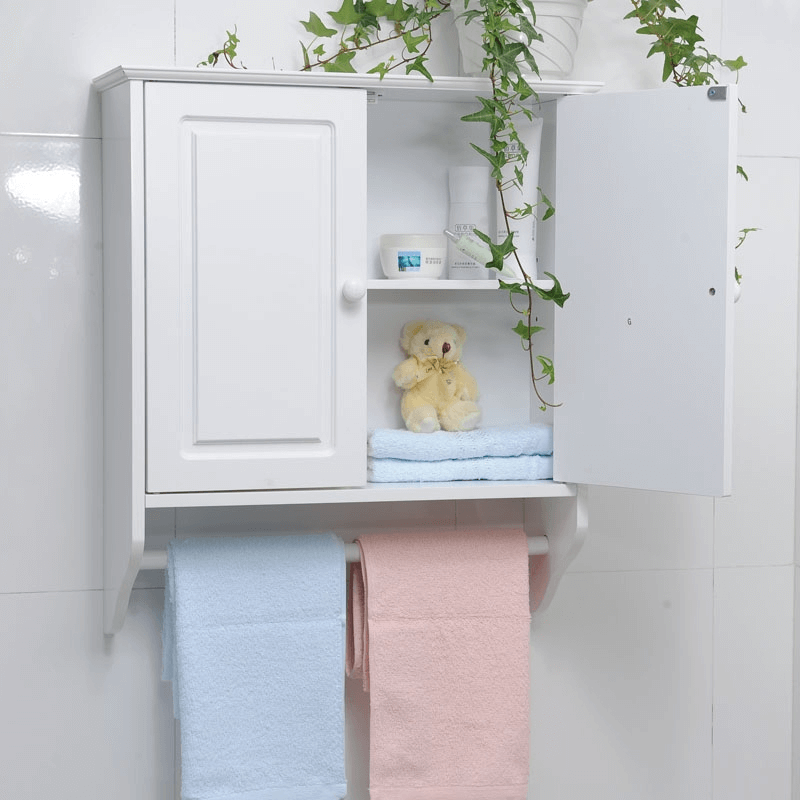 White bathroom cabinets with towel bar
