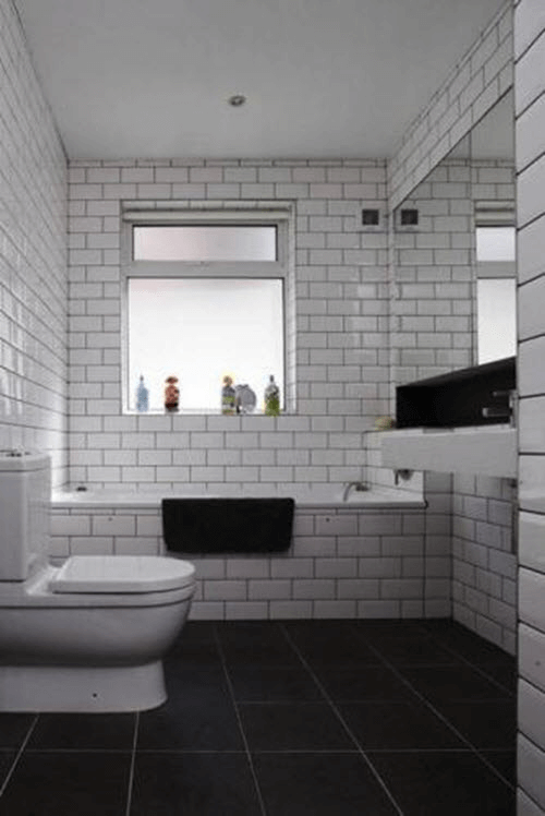 Bathroom Dark Tiles and White Walls