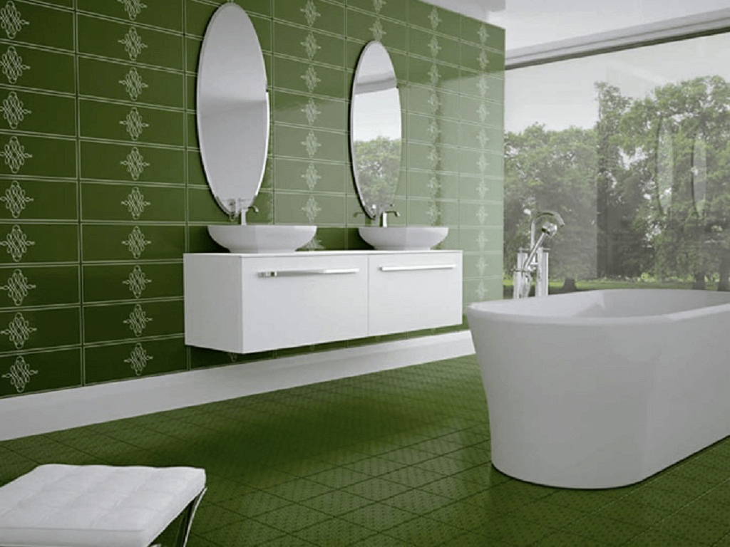 Green wall and floor tile bathroom with white bathtube and vanity sink