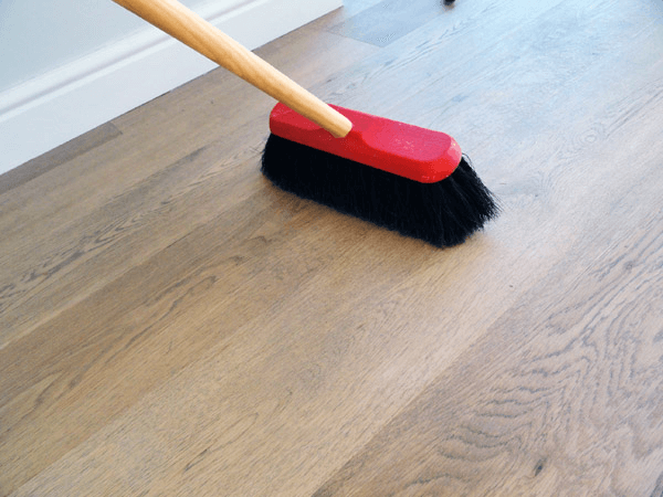 Cleaning wood floor from dust and others