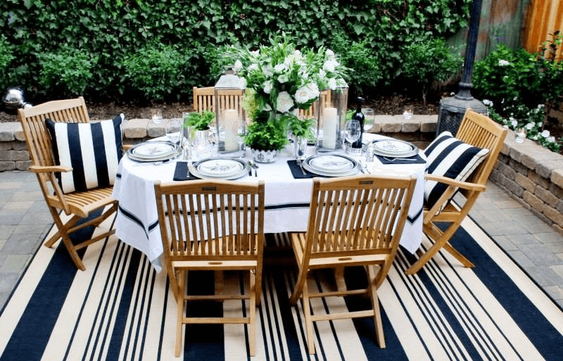 How to Decorate Outdoor Dining Table with blue and white Scot Meacham teak furniture