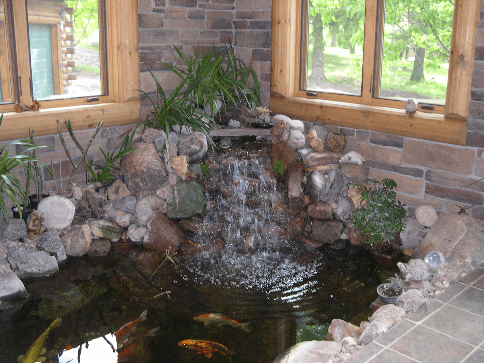 Indoor fish pond waterfall
