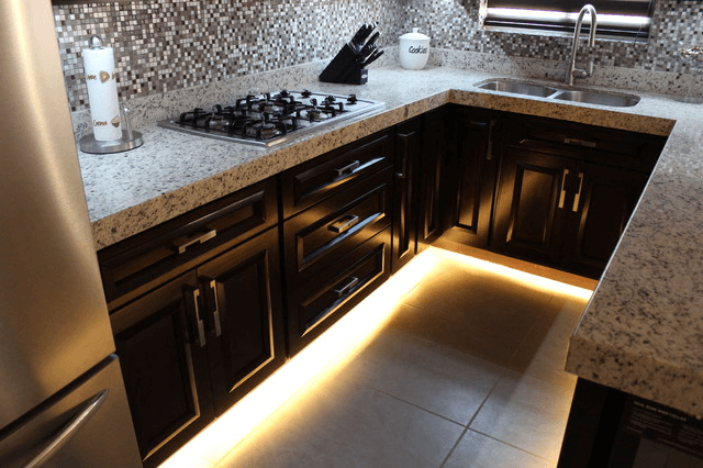 Under cabinet toe kick lighting for contemporary modern kitchen design