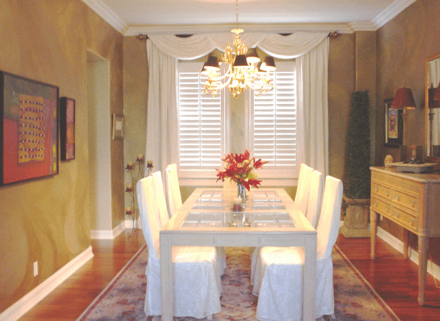 Gold themed traditional dining room wall decor with window curtain