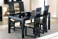 How to Decorate a Black Glass Dining Table