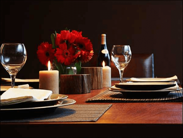 Valentine dining table decoration with flower and candle