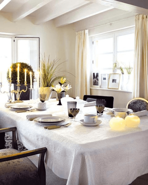 Dining room table decor with charger and chandelier for small family