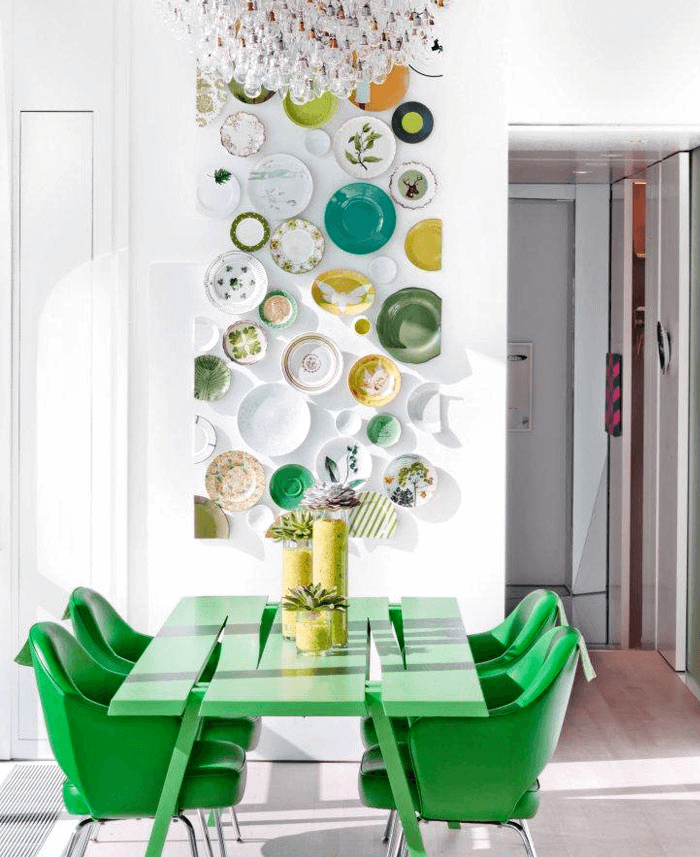 Green dining room table with plates wall decor ideas