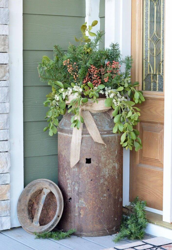 Rustic farmhouse porch decor with old milk container