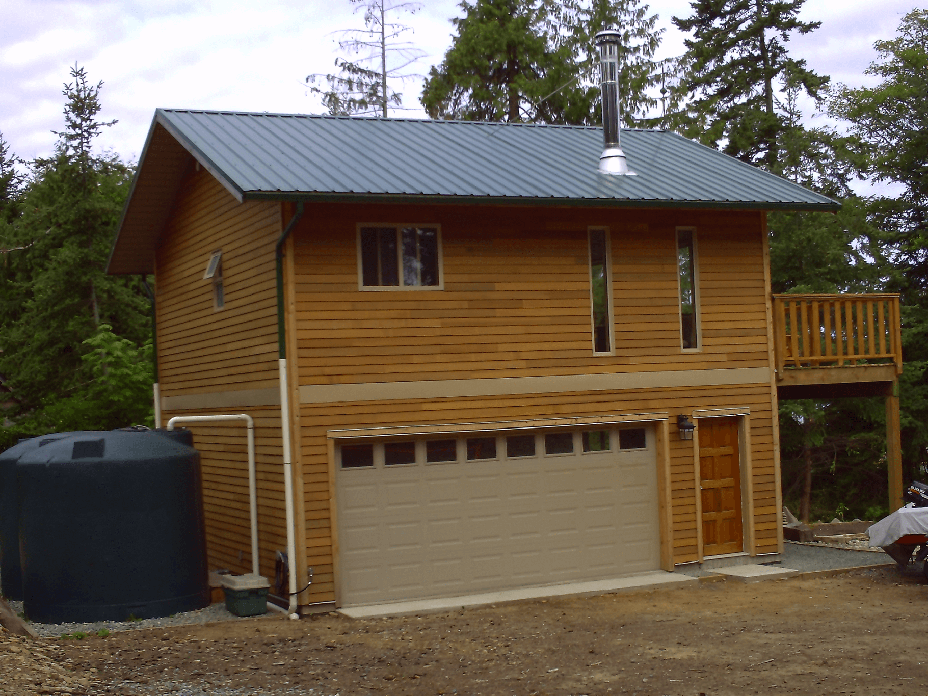 Wooden tiny house design with garage