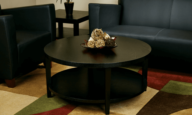 Colorfull Rug And Tray On Round Black Coffee Table Decor