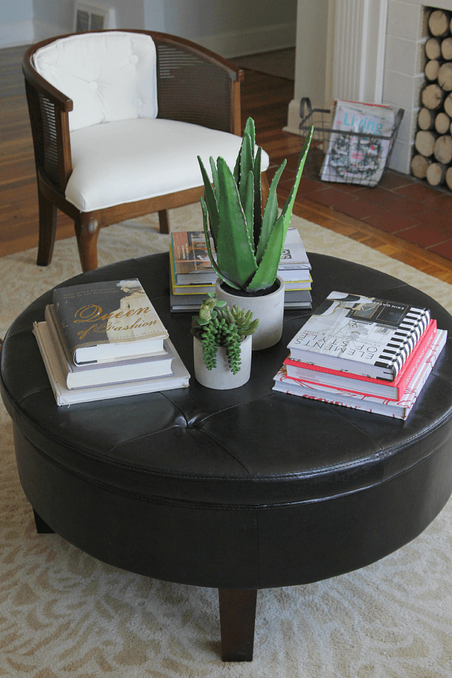 Round coffee table living room decor ideas with book, succulent, terrarium, or other plants