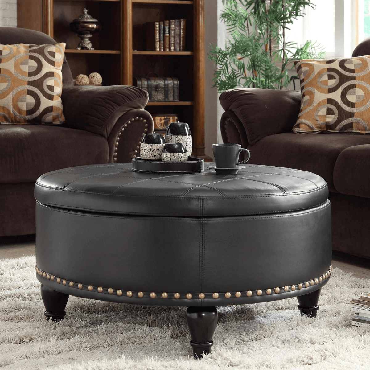 Simple ceramics and unique glassware for leather cover black round coffee table living room decor ideas