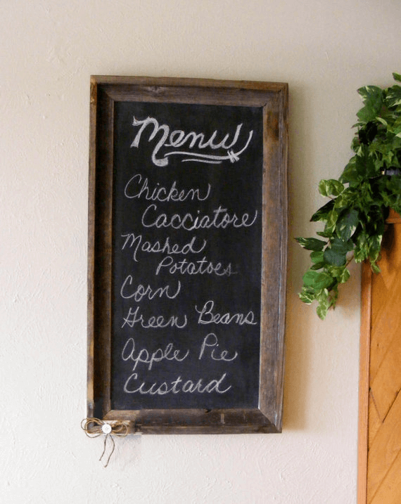 Kitchen menu board with chalk and blackboard