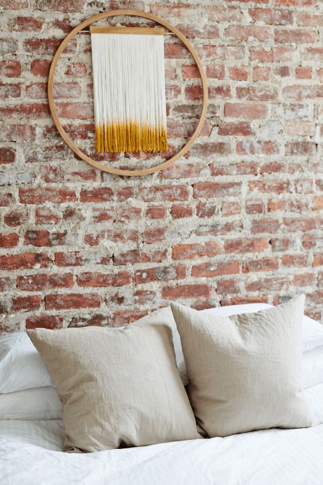 Tassel Garland for exposed brick wall decorating ideas