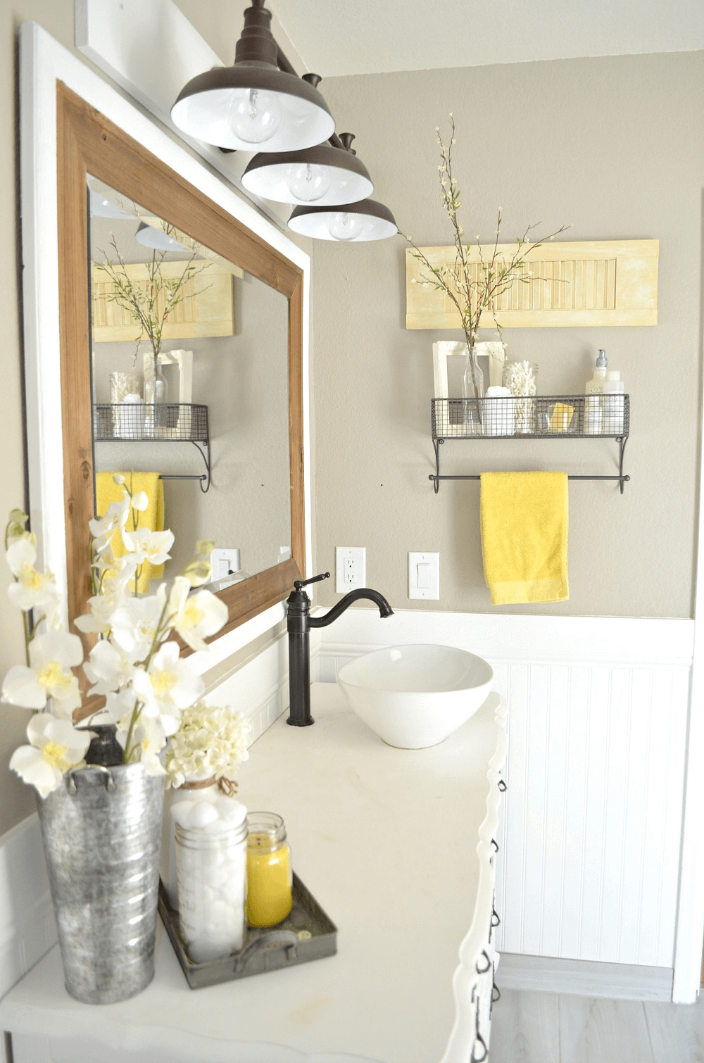 Farmhouse bathroom with plants, hanging lamp, and mirror as decor ideas