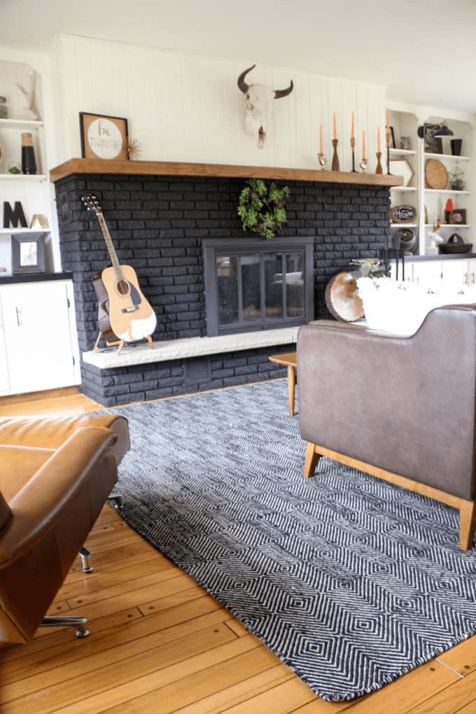 Black brick fireplace painted for contemporary room design ideas